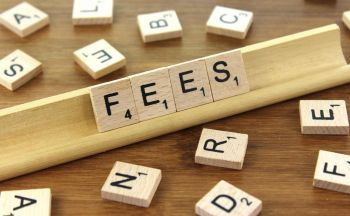 scrabble tiles reading fees