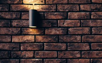 light on brick wall